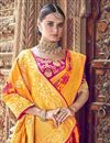 photo of Traditional Wear Silk Fabric Mustard Designer Weaving Work Saree With Heavy Blouse