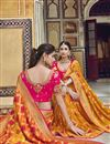 photo of Trendy Art Silk Function Wear Orange Weaving Work Saree With Embroidered Blouse
