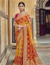 image of Trendy Art Silk Function Wear Orange Weaving Work Saree With Embroidered Blouse