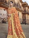 image of Eid Special Designer Silk Fabric Function Wear Orange Weaving Work Saree With Embroidered Blouse
