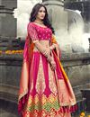 image of Eid Special Function Wear Art Silk Fabric Embroidered Rani Color Traditional Lehenga Choli