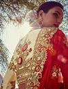 photo of Cream And Red Color Wedding Wear Embroidered Fancy Fabric Designer Lehenga Style Saree