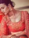 photo of Attractively Embroidered Peach And Pink Color Bridal Wear Fancy Fabric Lehenga Saree