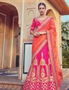 image of Bridal Wear Pink And Orange Color Fancy Fabric Embroidered Lehenga Style Saree