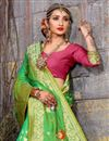 photo of Tantalizing Weaving Designs On Green Occasion Wear Saree In Art Silk