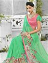 photo of Georgette Fabric Designer Saree In Green Color With Banglori Silk Blouse