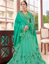 photo of Spellbinding Green Color Festive Wear Silk And Net Fabric Designer Embroidered Saree