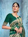 photo of Dark Green Color Trendy Puja Wear Art Silk Fabric Weaving Work Saree