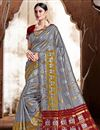 image of Puja Wear Grey Color Trendy Art Silk Fabric Weaving Work Saree