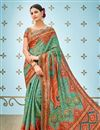 image of Banarasi Silk Fabric Designer Saree In Teal With  Printed Designs And Attractive Blouse