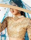 photo of Teal Color Sangeet Wear Net Fabric Thread Embroidered Lehenga Choli