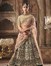 image of Dark Green Designer Bridal Lehenga With Embroidery Work On Velvet Fabric