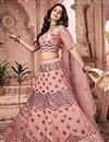 image of Net Fabric Wedding Wear Peach Color Fancy Work Lehenga Choli