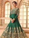 image of Mesmeric Fancy Fabric Embroiderd Dark Green Color Designer Anarkali Suit