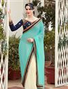 image of Georgette Party Wear Designer Cyan And Off White Color Saree With Unstitched Blouse