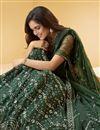 photo of Wedding Wear Net Fabric Embroidered Lehenga Choli In Dark Green Color