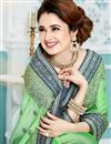 photo of Yuvika Chaudhary Featuring Green Color Function Wear Embroidered Designer Saree With Raw Silk Fabric Blouse