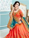 photo of Designer Wedding Wear Saree In Blue And Orange Color Crepe And Silk Fabric With Beautiful Designs Featuring Yuvika Chaudhary
