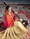 photo of Orange And Cream Color Party Wear Chiffon Designer Saree