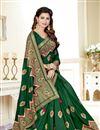 photo of Fancy Traditional Wear Dark Green Weaving Work Saree In Uppada Silk