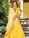 image of Embroidery Work On Wedding Wear Bridal Lehenga In Yellow Fancy Fabric With Blouse