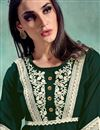 photo of Fancy Festive Wear Dark Green Color Rayon Fabric Embroidered Kurti