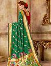 photo of Weaving Work Art Silk Fabric Green Fancy Function Wear Traditional Saree