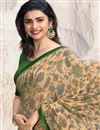 photo of Prachi Desai Function Wear Saree With Printed Design In Chikoo Fancy Fabric