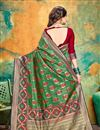 photo of Banarasi Silk Fabric Dark Green Color Festive Wear Saree With Weaving Work And Attractive Blouse
