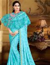 image of Function Wear Cyan Fancy Fabric Saree With Trendy Poncho Blouse