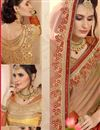 photo of Striking Embroidery Designs On Designer Saree In Rust Satin