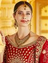 photo of Wedding Wear Red Color Velvet Fabric Embroidered Lehenga