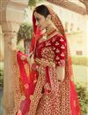 photo of Velvet Fabric Bridal Wear Embroidered Lehenga In Red Color