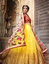 image of Exclusive Embroidered Net Fabric Bridal Lehenga In Yellow Color with Designer Choli