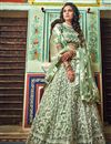 photo of Eid Special Exclusive Embroidered Wedding Wear Lehenga Choli In Net Fabric Sea Green Color