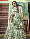 image of Eid Special Exclusive Embroidered Wedding Wear Lehenga Choli In Net Fabric Sea Green Color