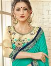 photo of Cyan Party Wear Georgette Embellished Fancy Saree
