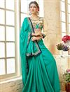 image of Cyan Party Wear Georgette Embellished Fancy Saree