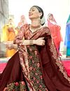 photo of Georgette Function Wear Brown Embellished Saree With Lace Border