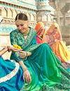 photo of Fancy Wedding Wear Georgette Turquoise Color Saree With Lace Border