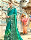 image of Fancy Wedding Wear Georgette Turquoise Color Saree With Lace Border