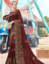 image of Embroidered Designs On Brown Georgette Fabric Party Wear Saree