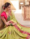 photo of Sangeet Wear Designer Traditional Saree In Art Silk Green With Heavy Embroidery