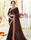image of Striking Georgette Designer Brown Saree With Fancy Embroidery Work