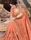 photo of Festive Wear Georgette Embroidered Fancy Peach Saree