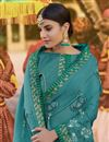 photo of Georgette Function Wear Embroidered Designer Saree In Cyan
