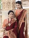 photo of Georgette Traditional Wear Fancy Embroidered Saree In Maroon