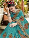 photo of Party Wear Designer Thread Embroidered Cyan Saree In Georgette
