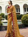 image of Alluring Printed Georgette Festive Wear Saree In Mustard
