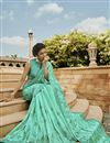 photo of Traditional Embroidered Satin Fabric Party Wear Designer Saree In Sea Green